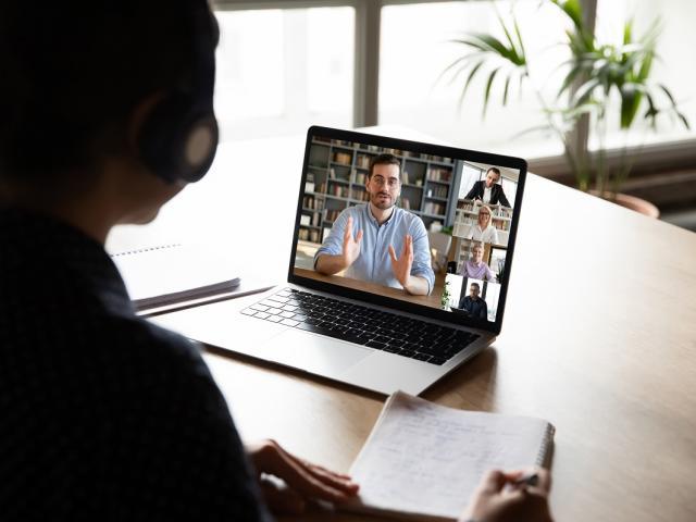Woman networking online on laptop in Community of Scholars team meeting