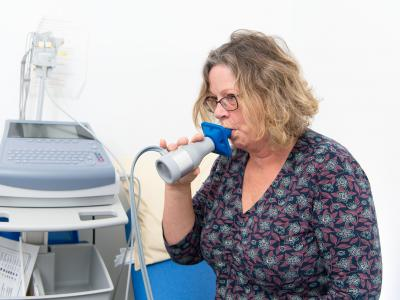 Woman taking lung capacity test